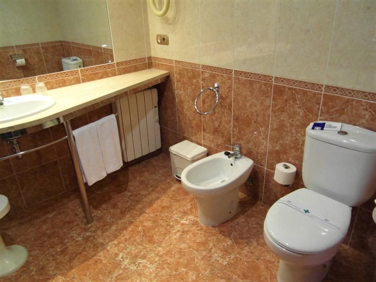 Sink, bidet and WC.