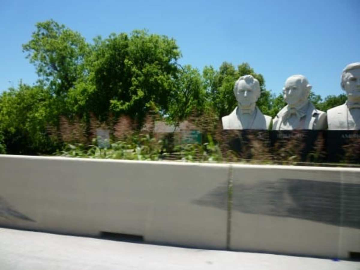 Zooming by American Statesmanship Park in our auto one day. I caught a partial view of it.