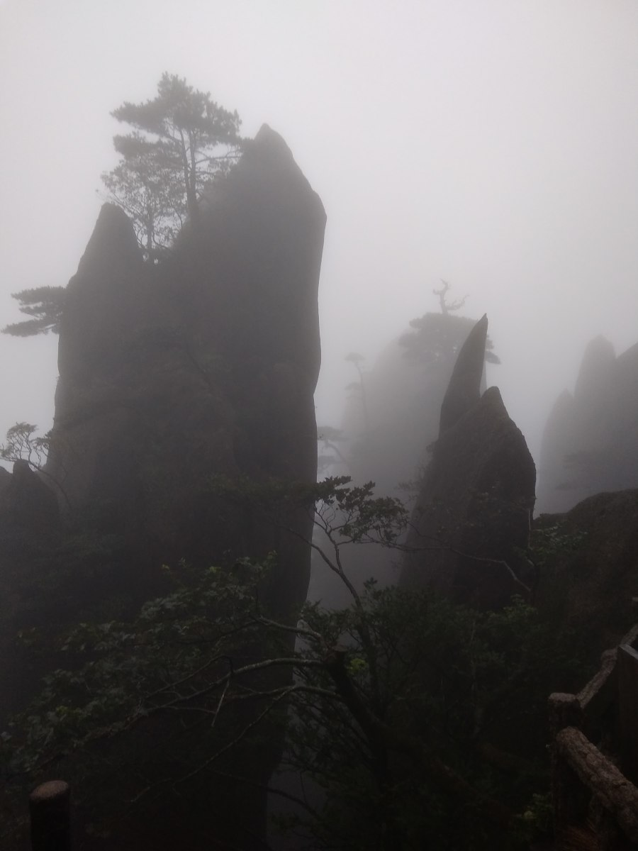 Ghostly shapes appear in the mist on Yellow Mountain.