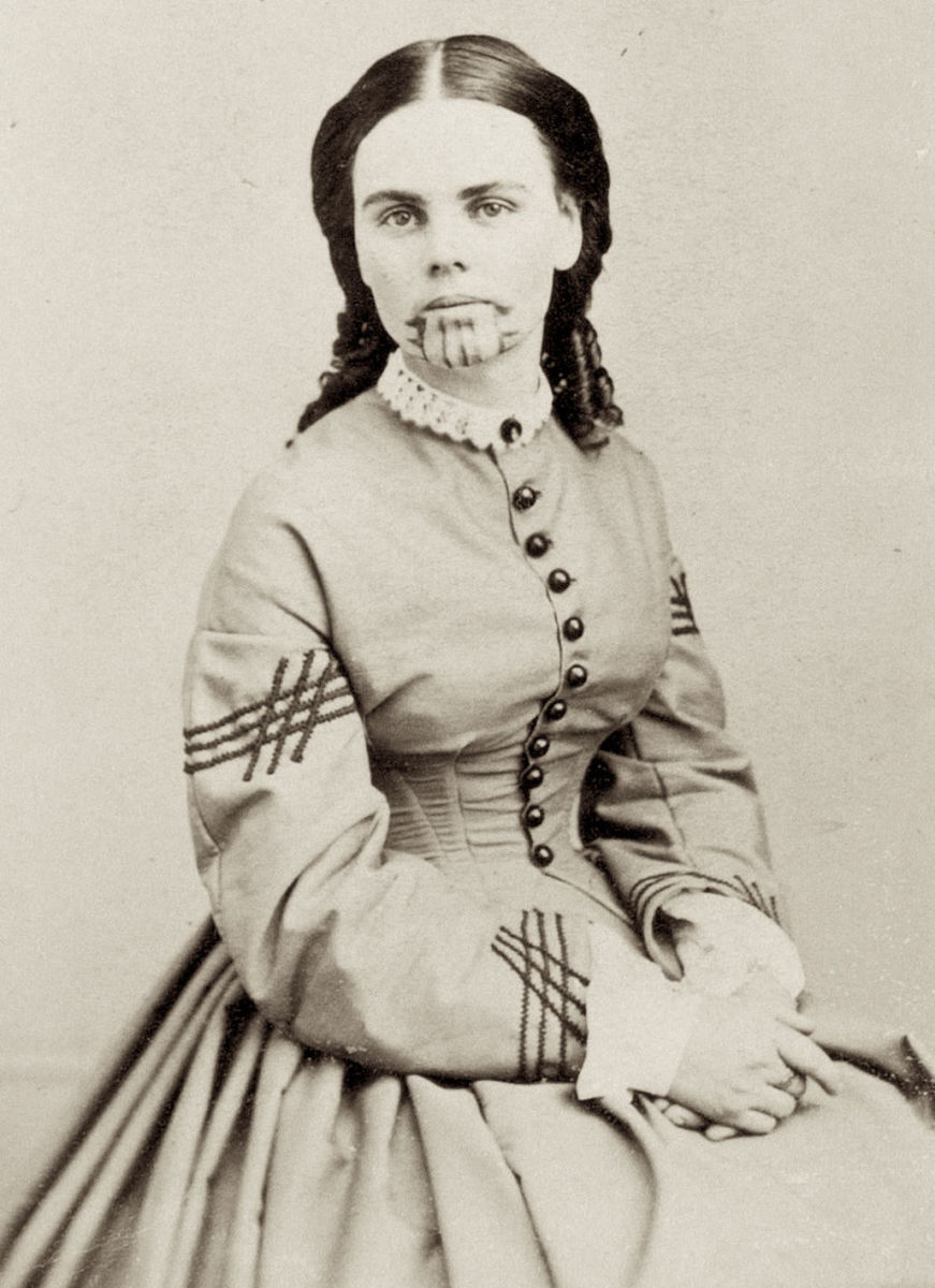 WikiPedia Photo of Olive Oatman from about 1863 about 7 years after her release from captivity.  Note the blue tattoo on her chin—a symbol of her being a member of the Mojave tribe.