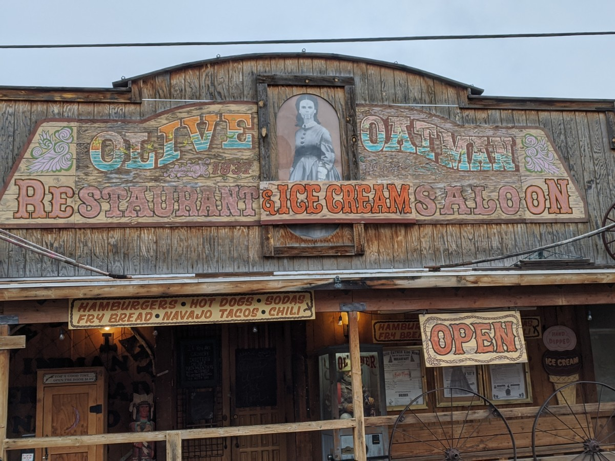 "Picture of Olive Oatman above the ""Olive Oatman Restaurant & Ice Cream Saloon"""