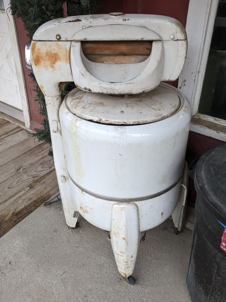 Washing machines like this one our grandmothers used to use.  It was better than washing by hand, but it had to be filled manually then drained and refilled to rinse, then run through ringer on top to wring out before hanging wash outside to dry.