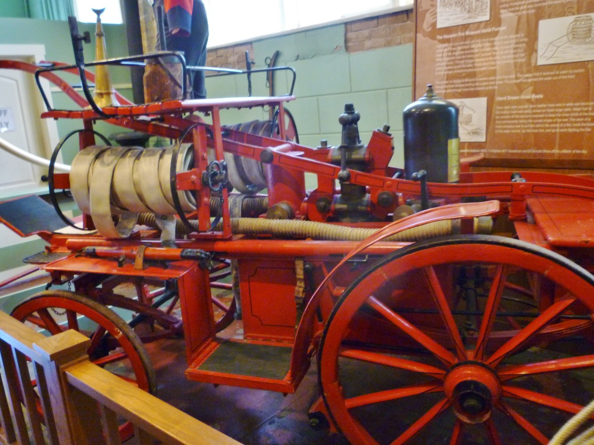 Side view of 19th-century hand-powered pumper