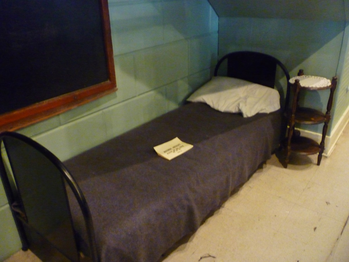 A bed inside of the museum