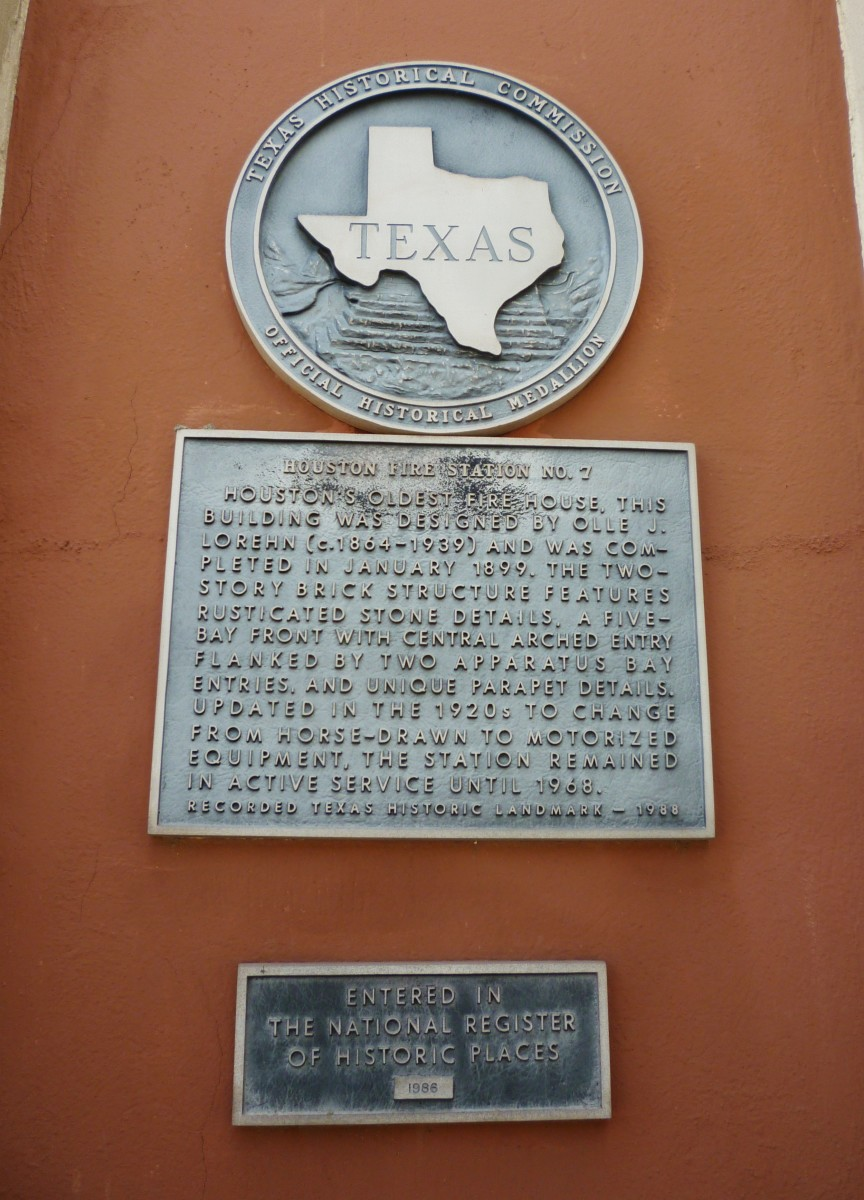 Historical medallion on building