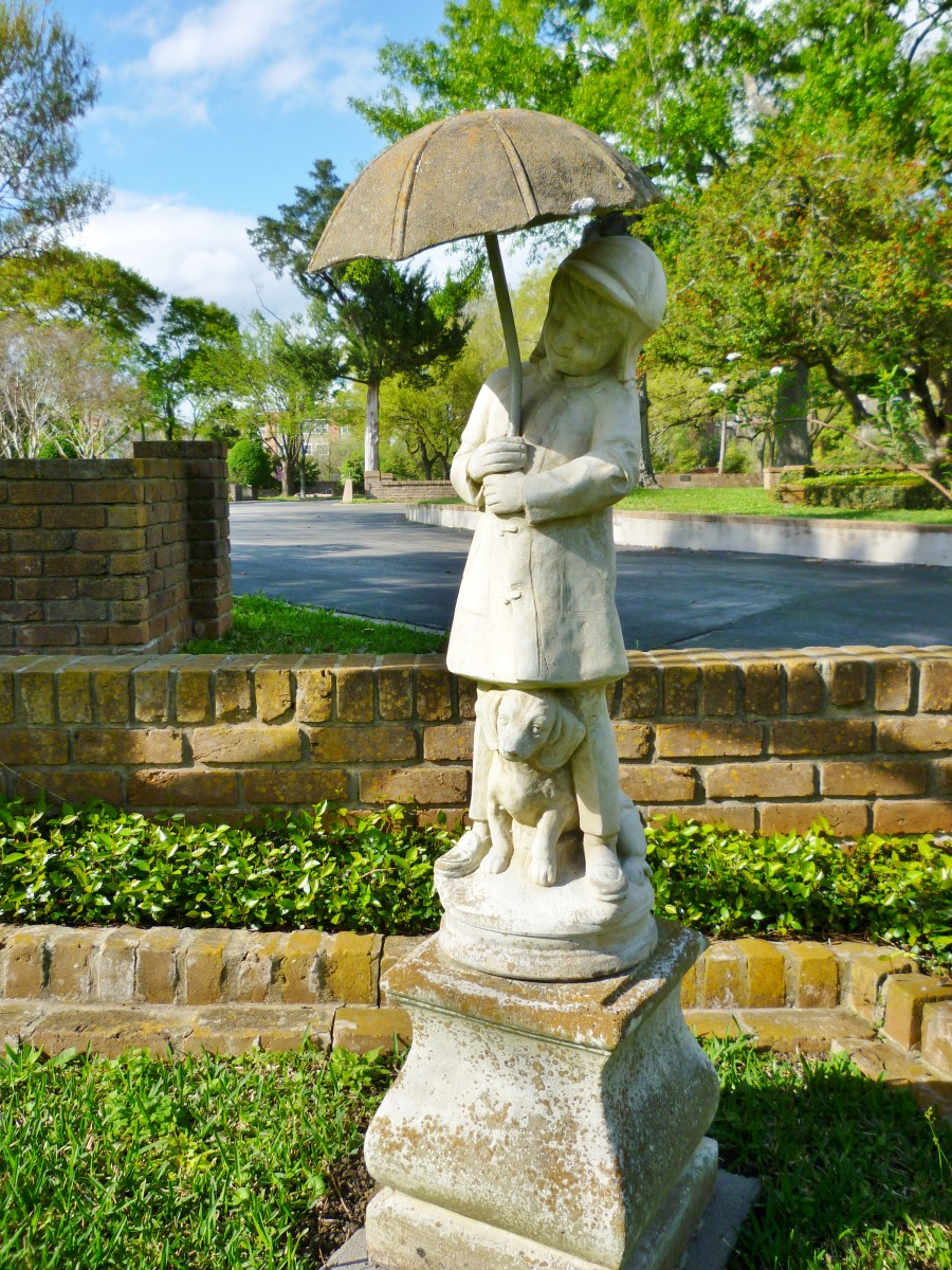 Little Girl with Umbrella & Dog monument