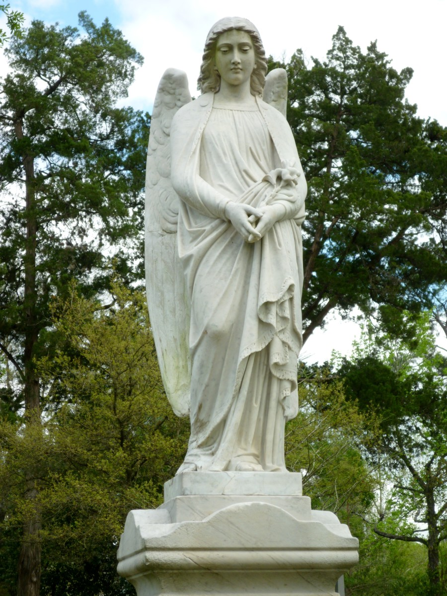 One of many angel monuments in the cemetery