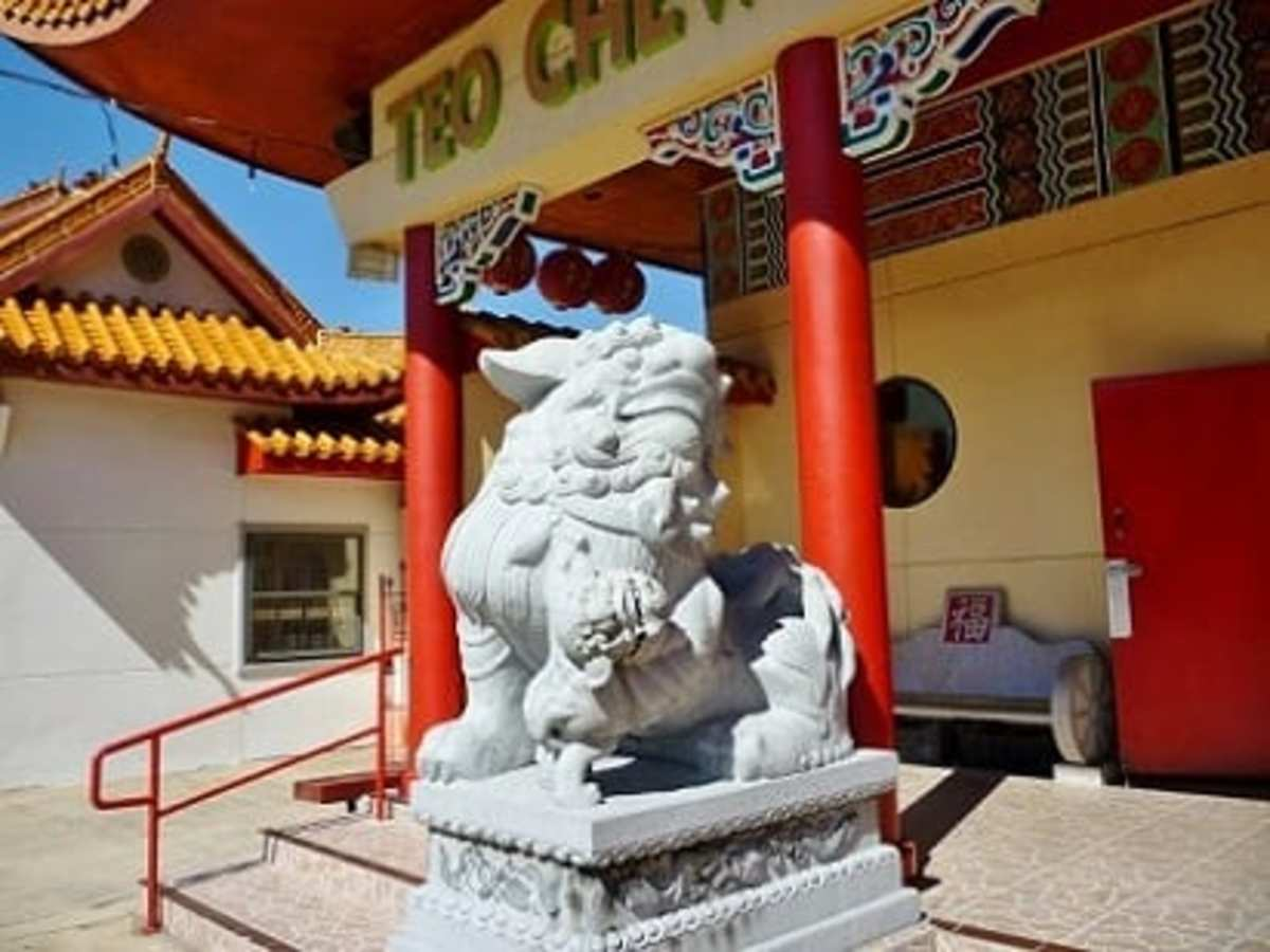Female lion in front entrance to the temple