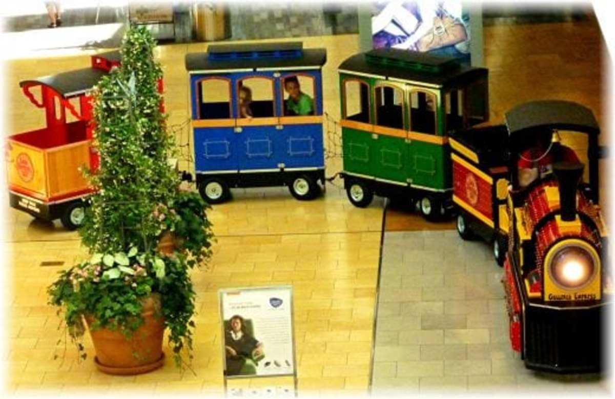 Small train takes people through the Galleria in Houston.