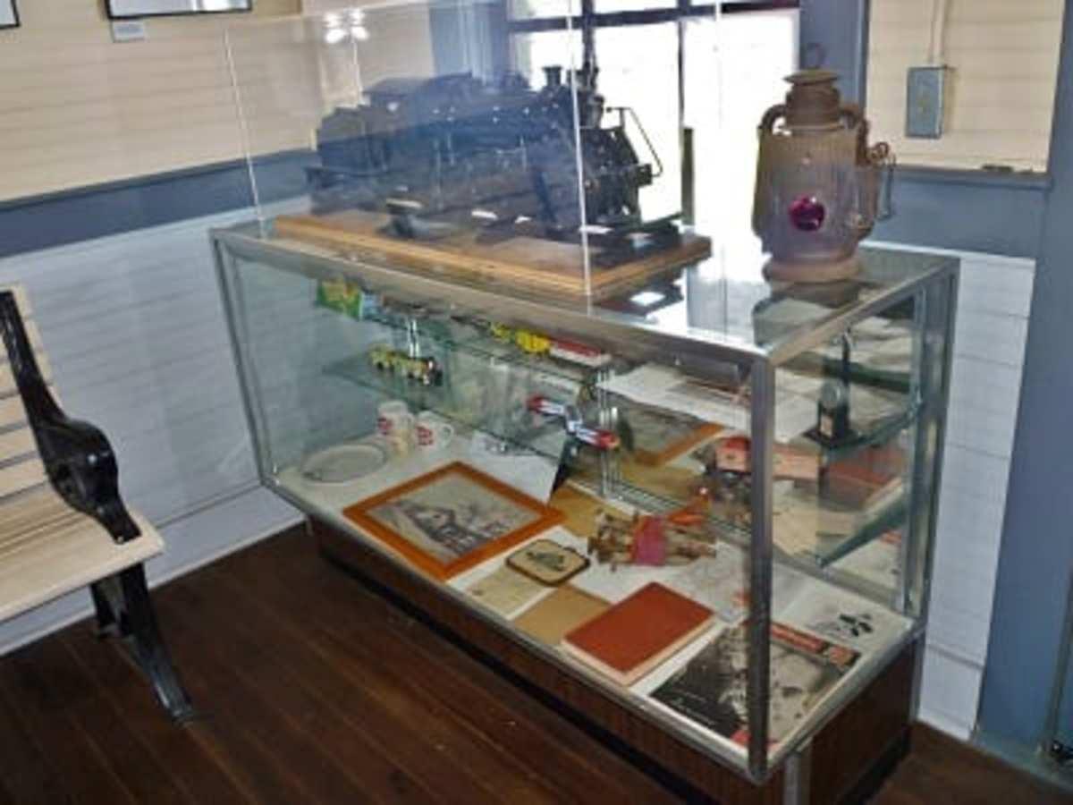 Cases of items on display at Katy RR station