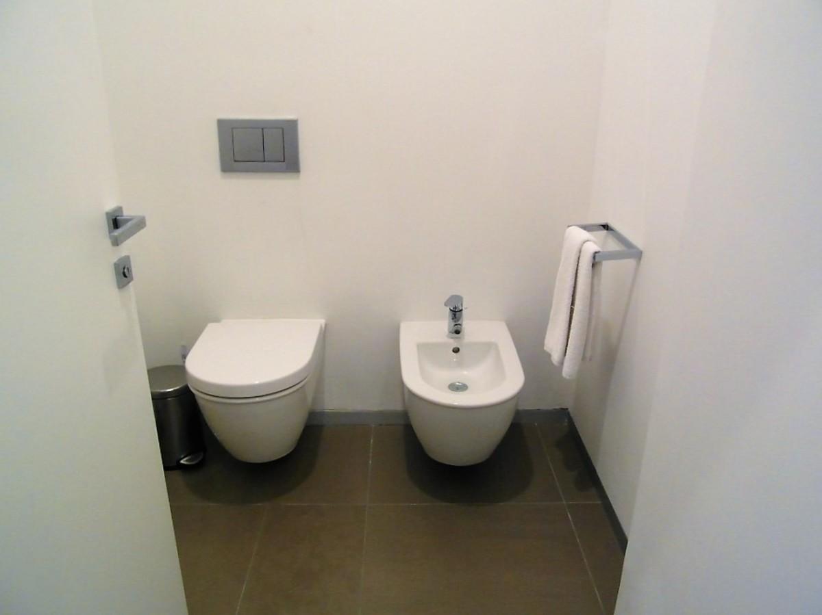 White-washed toilet area.