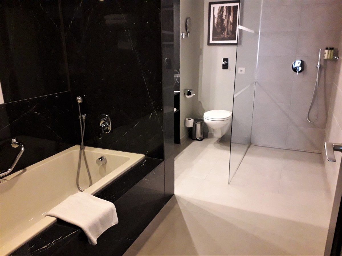 Bath, with shower and WC beyond.