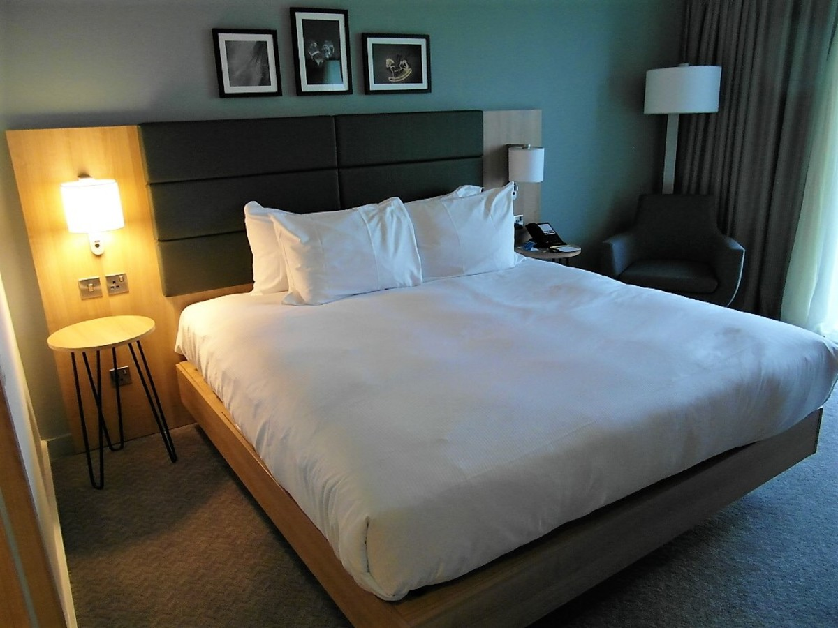 Comfortable King size bed with armchair in the corner.