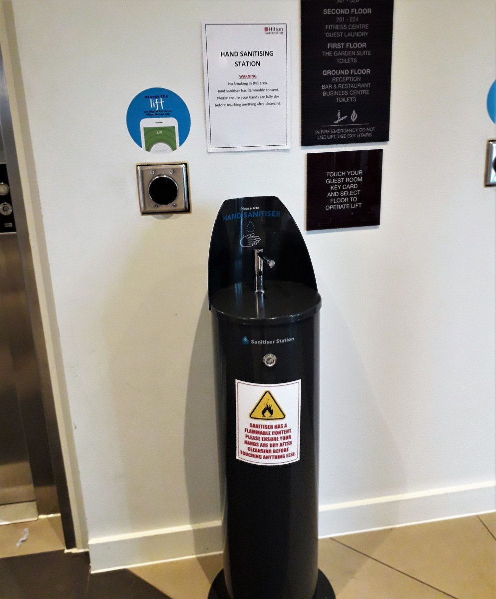 Hand sanitizer by the lifts on the ground floor, July 2020.
