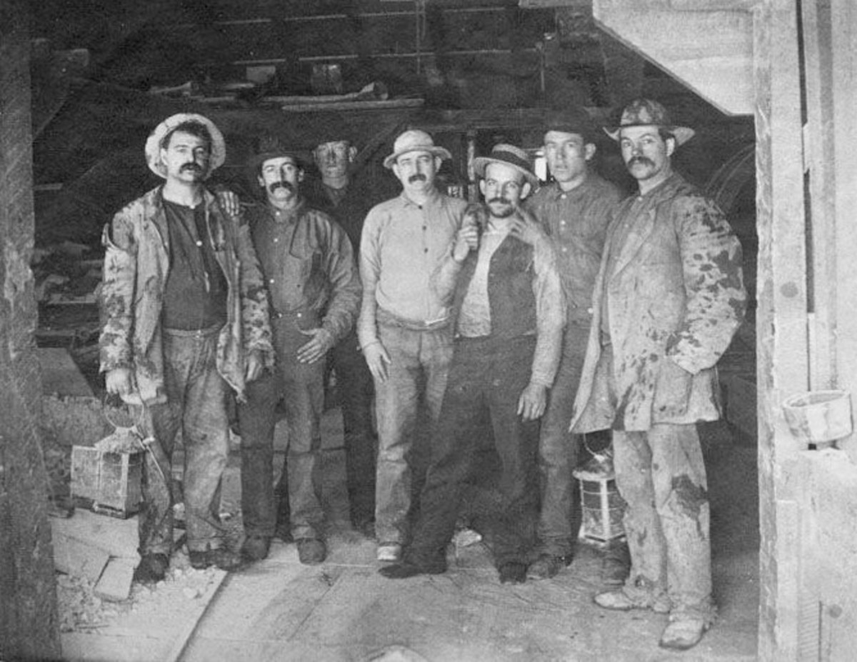 "Caption on image: ""To Labor is to Pray."" Frances S. Osgood. Photograph of seven men, Comstock miners, two holding lanterns; from the Alfred Doten collection; cyanotype."