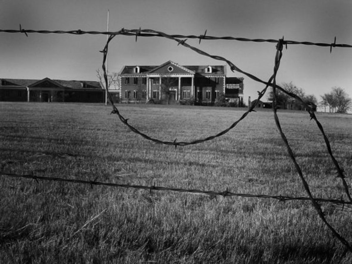 Viewing the house from behind the barbed wire fence.