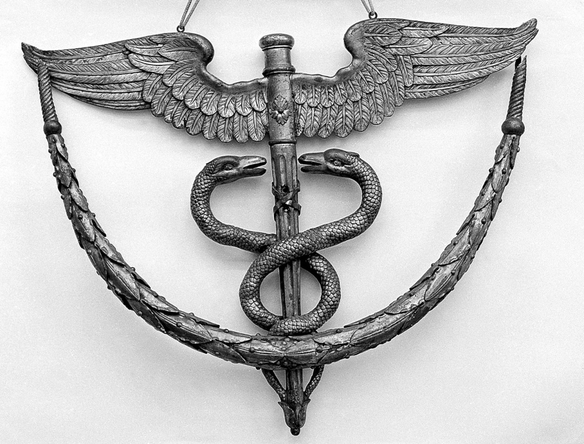 The caduceus, a symbol of healing often seen on healthcare buildings, symbols, and correspondence.
