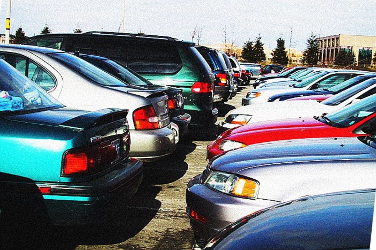 Parked cars represent going nowhere, which could be viewed both positively and negatively.
