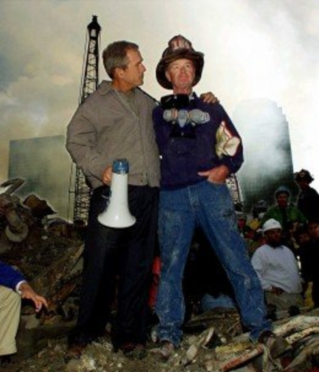 George Bush with a fireman wearing the number 164 on his helmet.