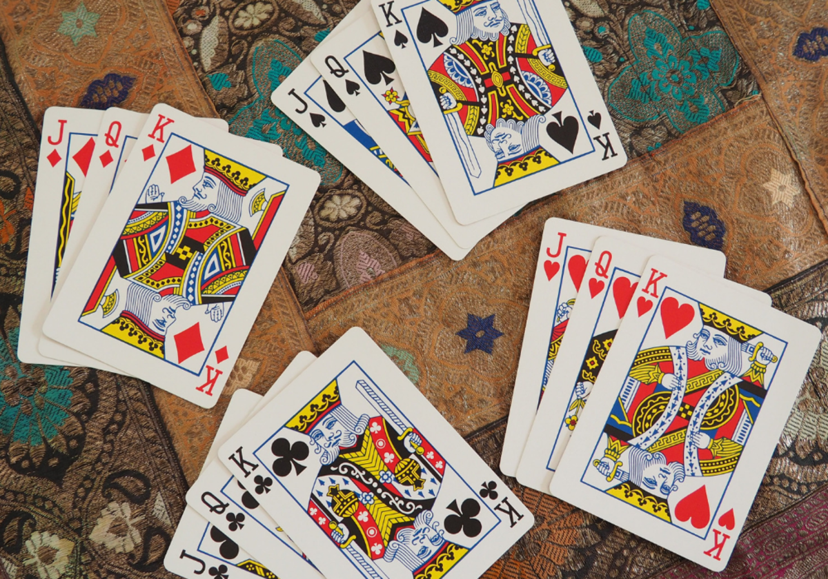 The face cards in a regular playing card deck correspond to court cards in a tarot deck.