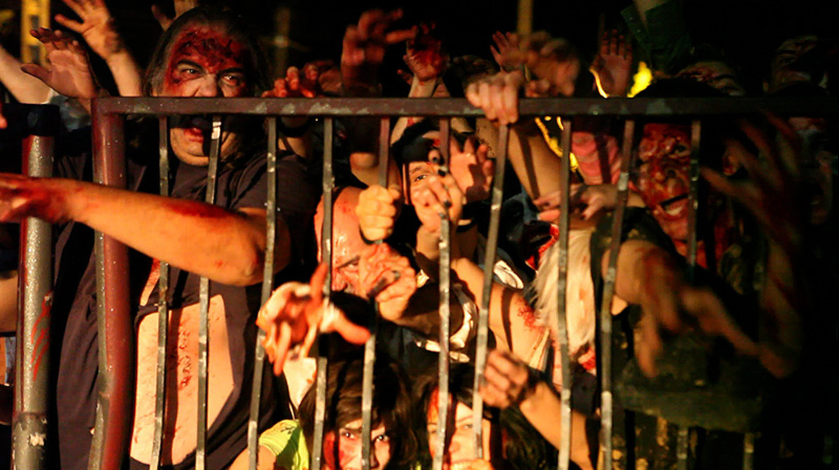 Dreaming of a zombie mob held back by fences/barriers may relate to the dreamer's defenses. Are you trying to contain what the zombies symbolize instead of confronting it?