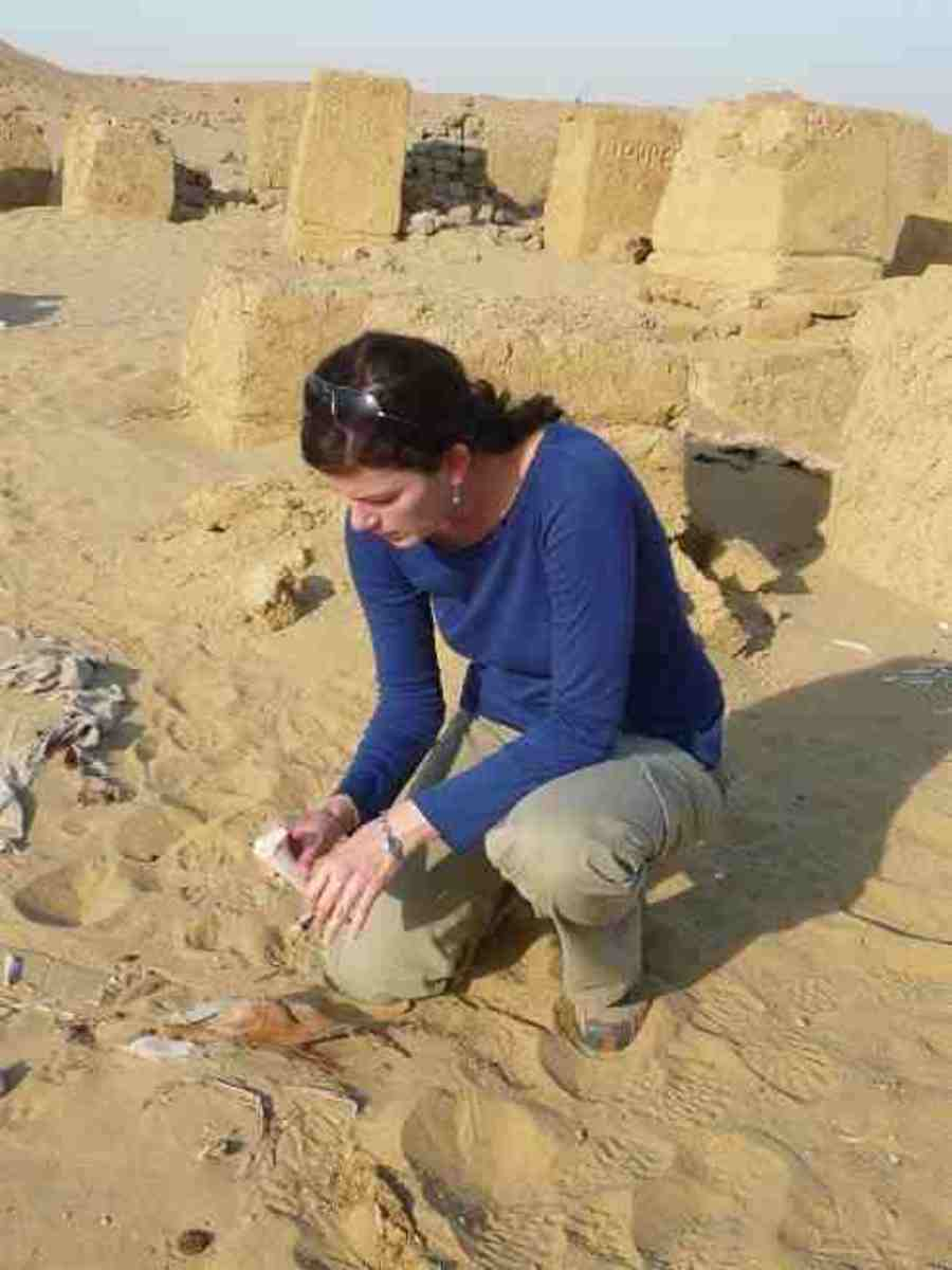 www.public-republic.net  Modern day woman archaeologist at work