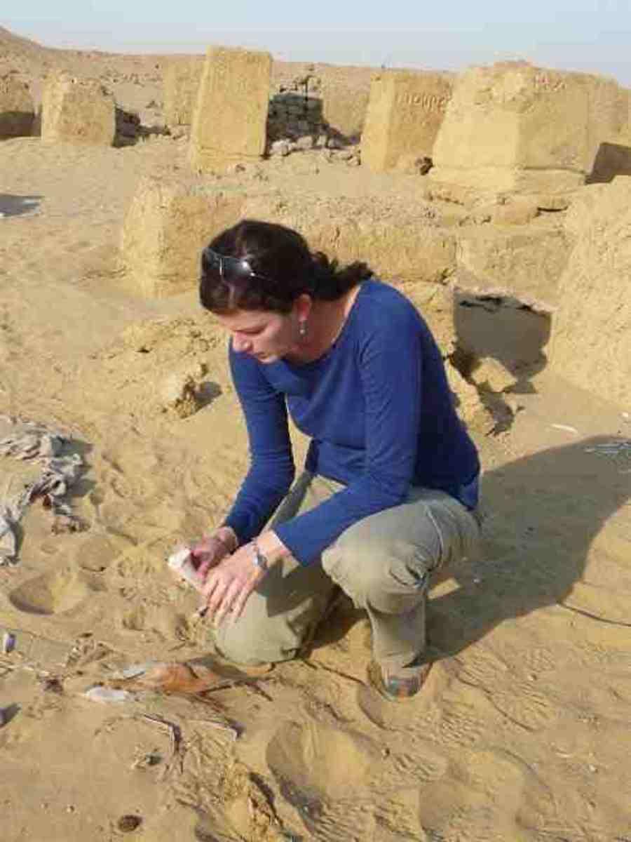 www.public-republic.net  Modern day woman archaeologist at work