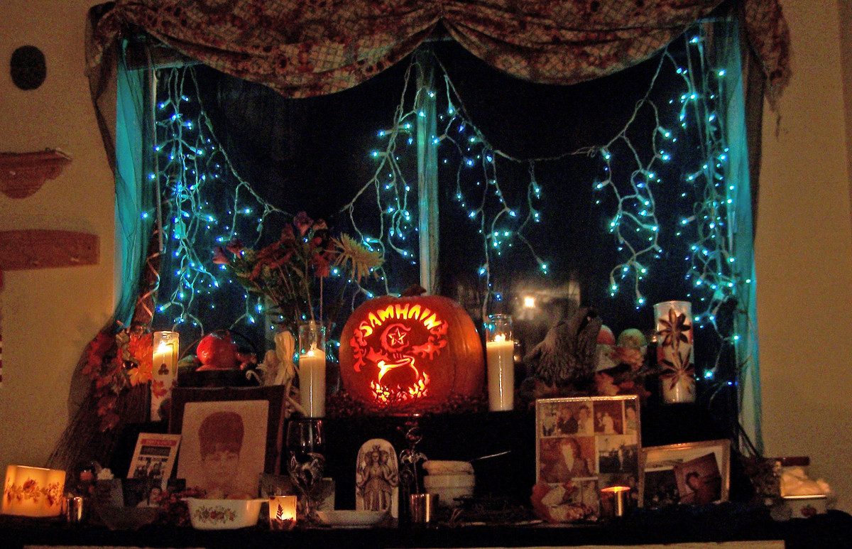 We host a big open house on Samhain, for the living and the dead. We set up a ritual altar for the actual ritual in a different room. But in the dining area we create this shrine to the ancestors for the season to honor them.