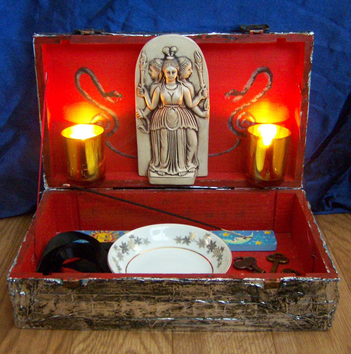 This shrine built into a box is convenient as I can pack it up when necessary and take it with me. If you live with people and don't feel comfortable keeping your shrine out in the open, this is a great solution.