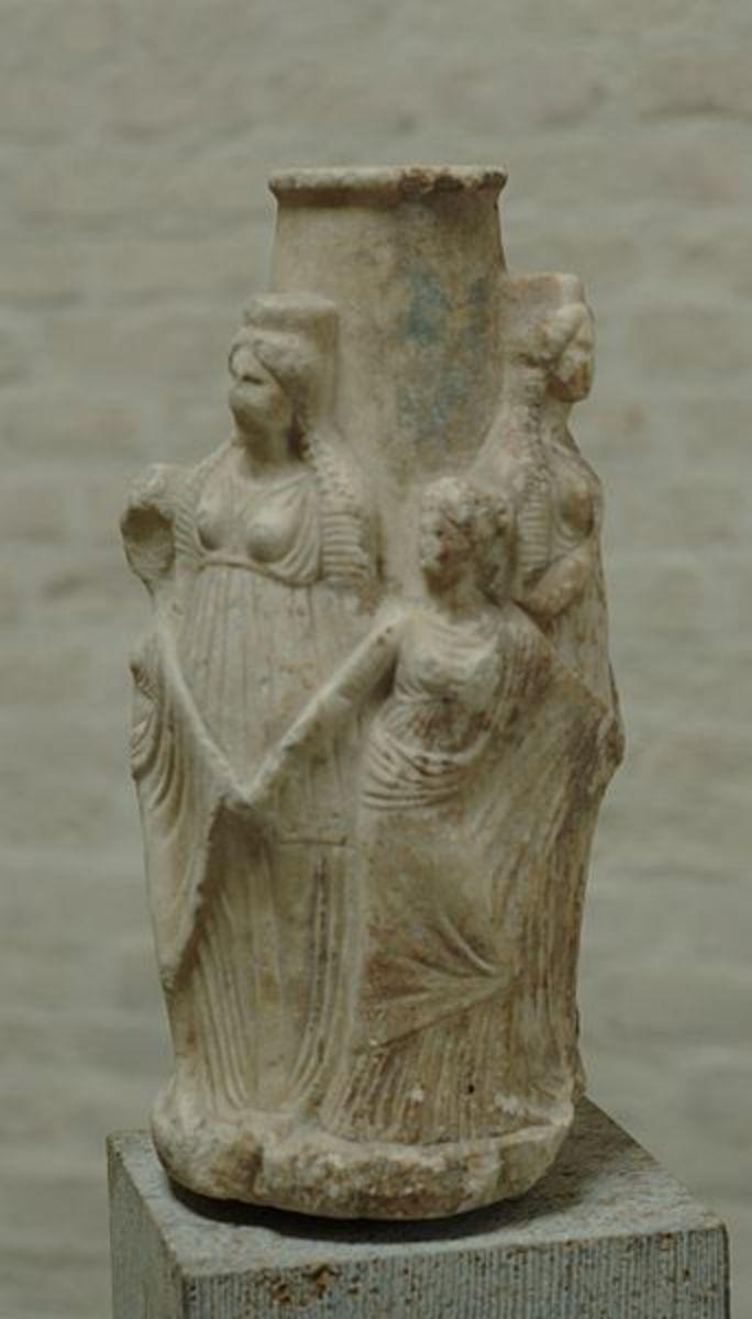 An ancient Hekate Triple Goddess statue.
