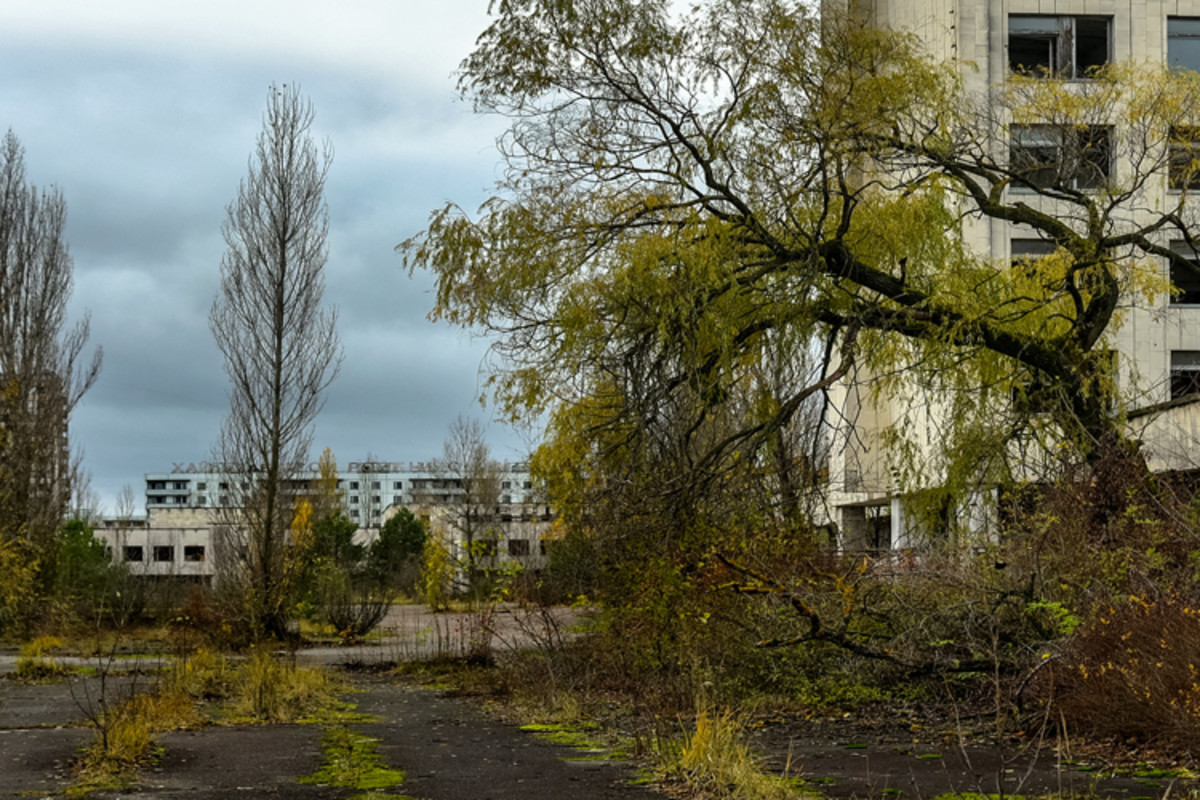 Ghost towns and a lifeless landscape surround the site of the 1986 Chernobyl disaster.