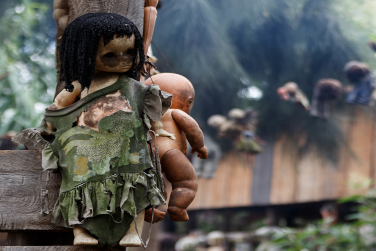 A remote island where hundreds of dolls hang from the trees, forever imprisoned.