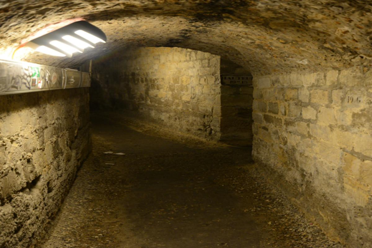 Wandering the dark tunnels of the Parisian catacombs.
