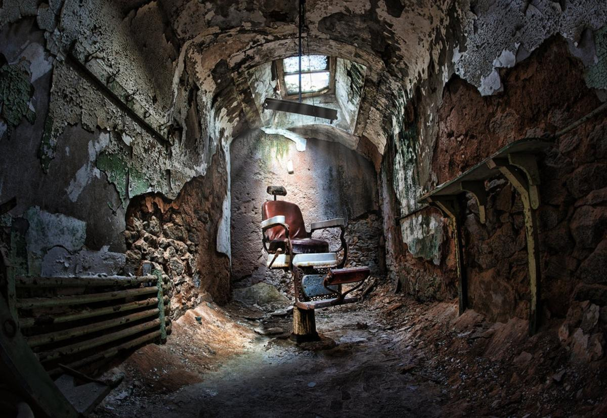 Barber chair in abandoned room at Eastern State Penitentiary.