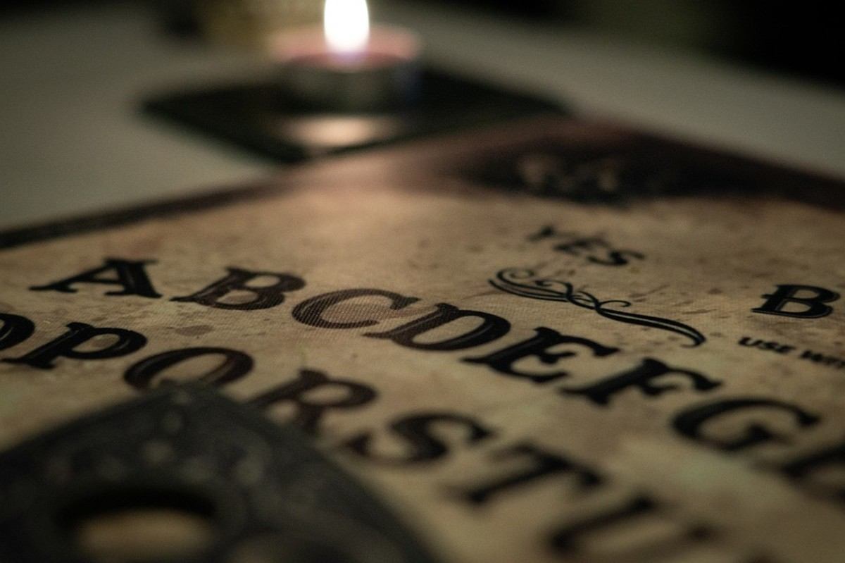 It seems to be a requirement that any image of a Ouija board must have a burning candle in the frame.