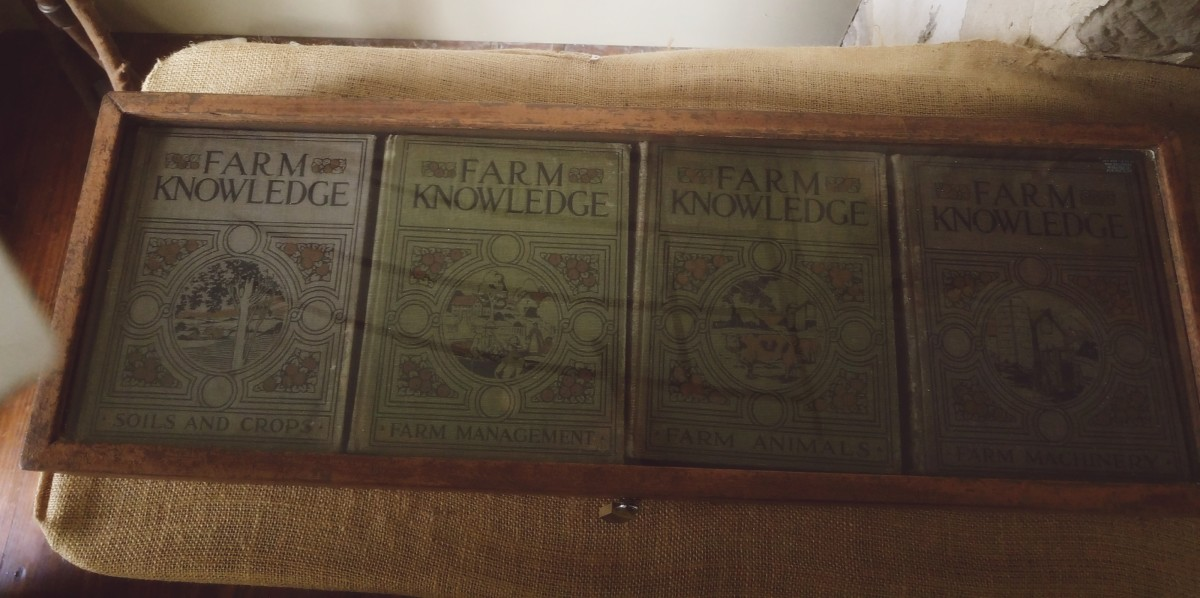 A collection of old books about farming.