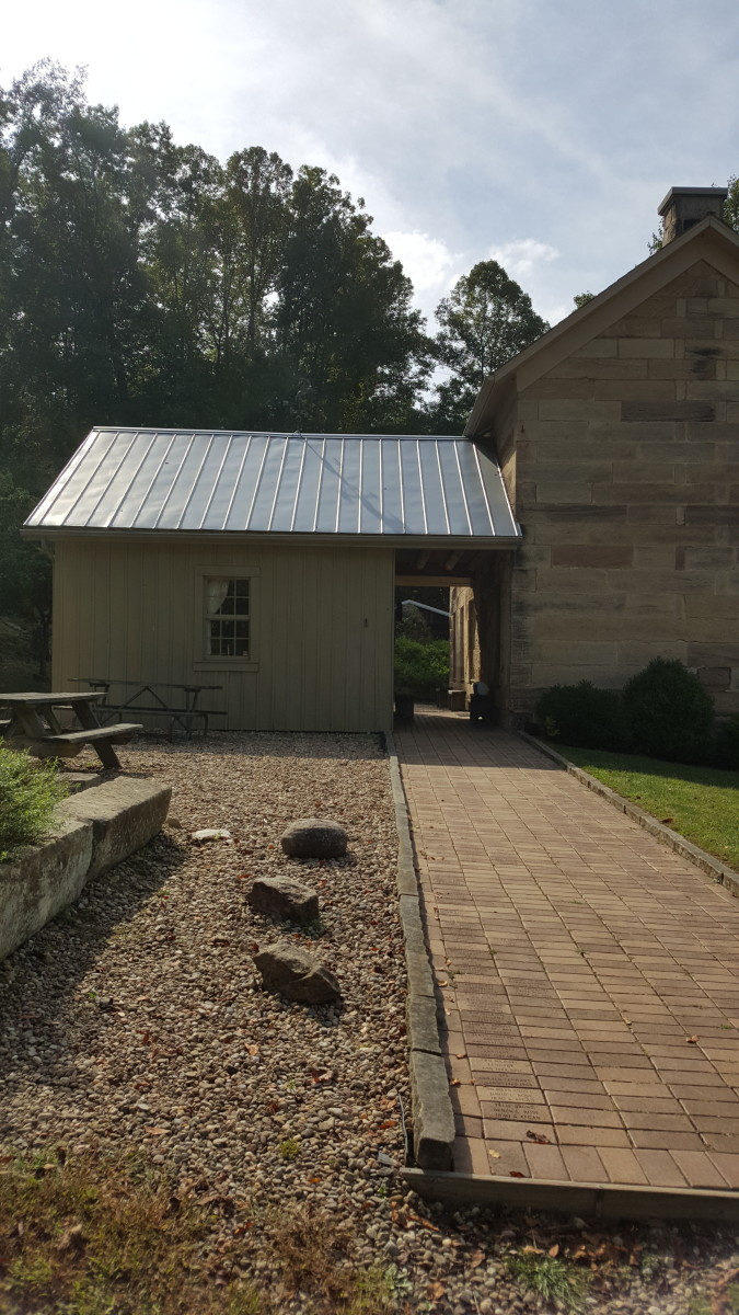 A view of the Stone House and attached Summer Kitchen.