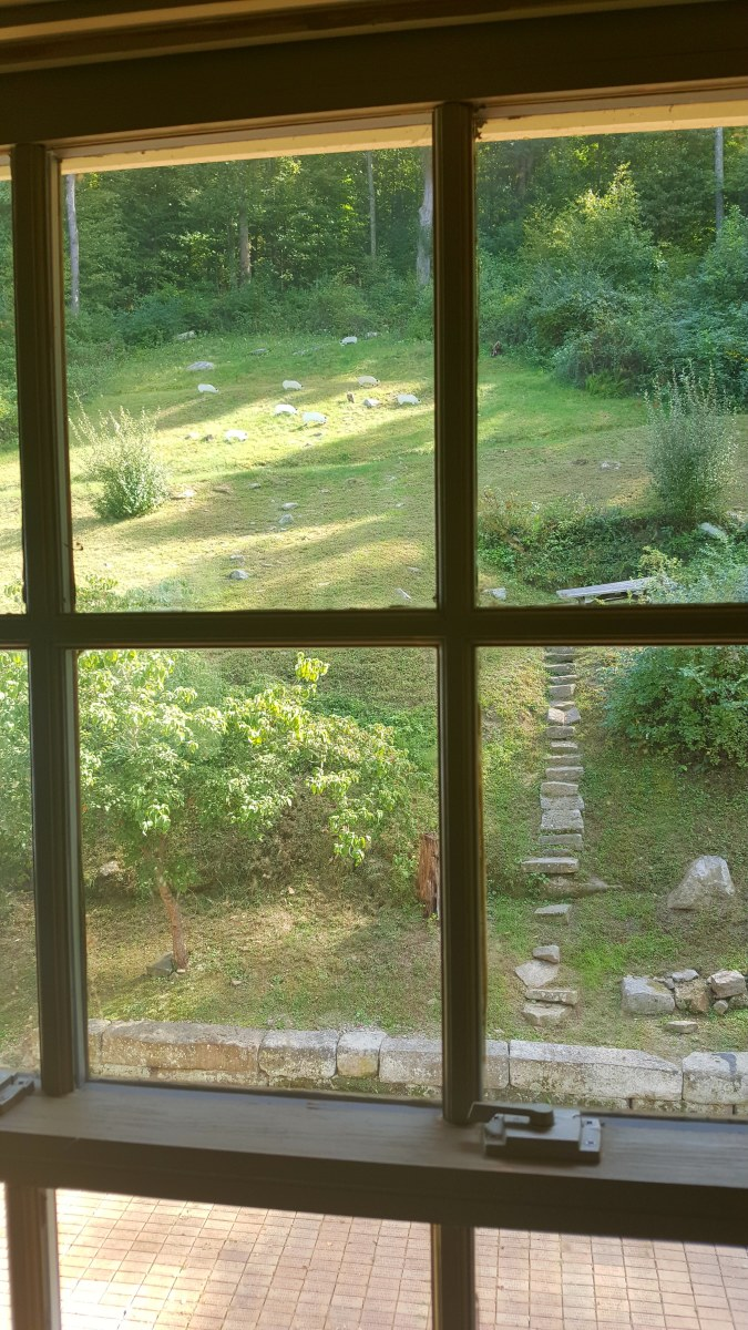 A view outside, where sheep may have grazed, from the upstairs.