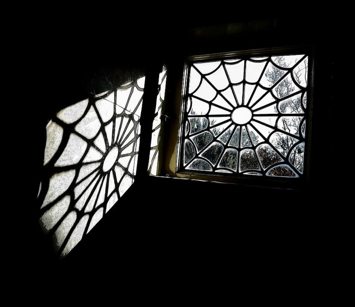 Spider-web windows are said to be one of Mrs. Winchester's innovations aimed at throwing the goblins off balance.