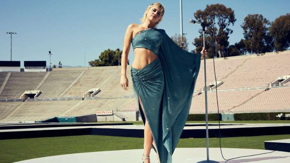 Miley Cyrus poses at the empty Rose Bowl in Pasadena, California