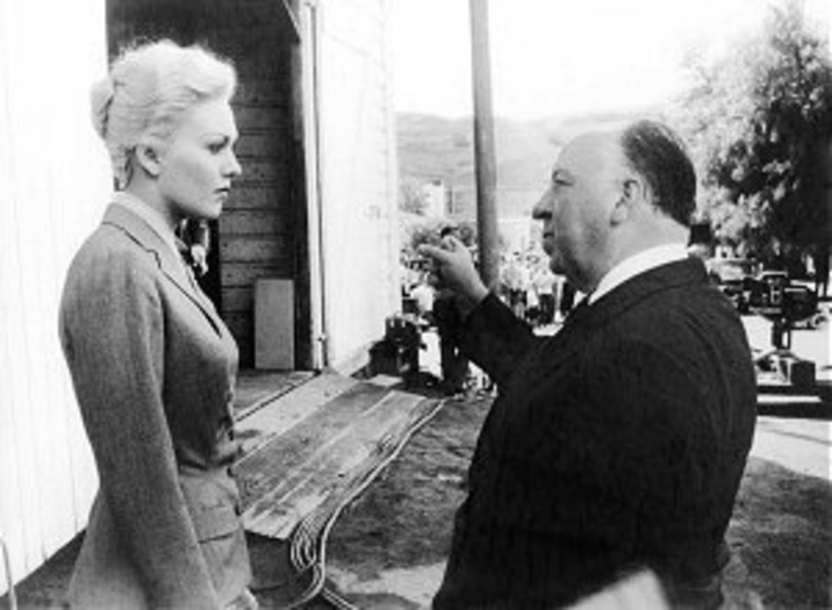 Director Alfred Hitchcock with one of his famous blonde stars, Kim Novak.
