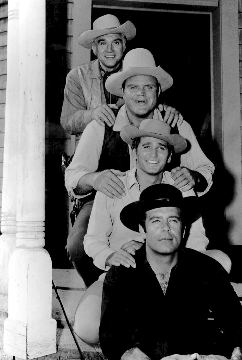 Pictures of the cast typically shows them with their hats on.