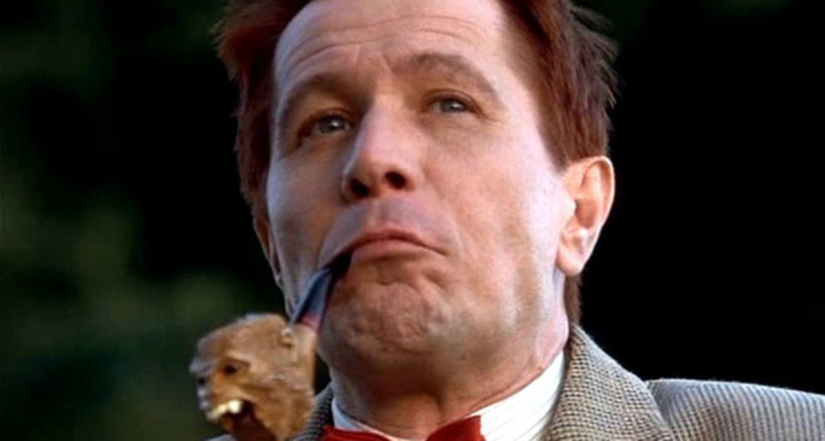 Gary Oldman as O. W. Grant.  Notice the monkey head pipe...maybe an allusion to the legend of the monkey's paw?