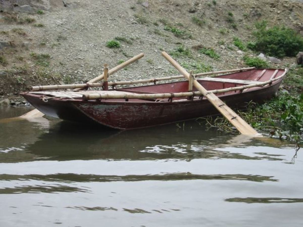The rowing boat that Robert rowed to take Cora to the Island