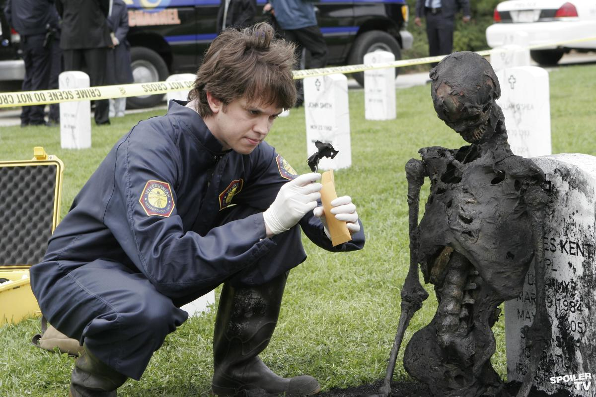 "Dr. Brennan's assistant, Zack Addy, examines the remains in the season one episode ""The Soldier On The Grave""."