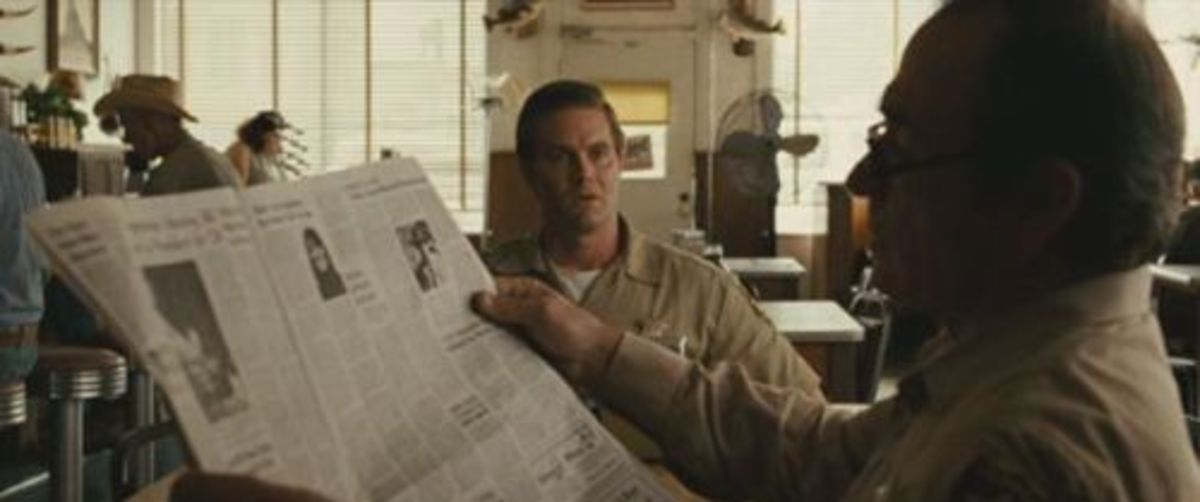 "In ""No Country for Old Men"" (2007) the page in Tommy Lee Jones' hands is the same as the one on the table, suggesting that the prop master bought 2 copies to make the paper look fuller, but made the mistake of leaving the stock spread facing up."