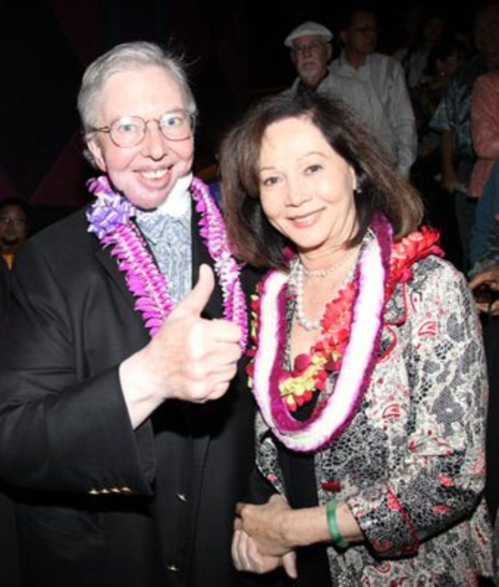 The Late Roger Ebert, standing beside Nancy Kwan. Photo taken in 2010.