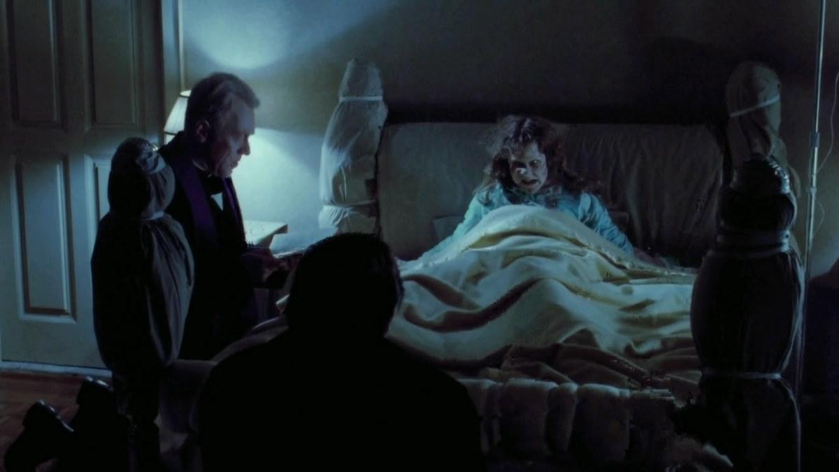 Fathers Lankester Merrin (Max Von Sydow) and Damien Karras (Jason Miller) with Regan MacNeil (Linda Blair)