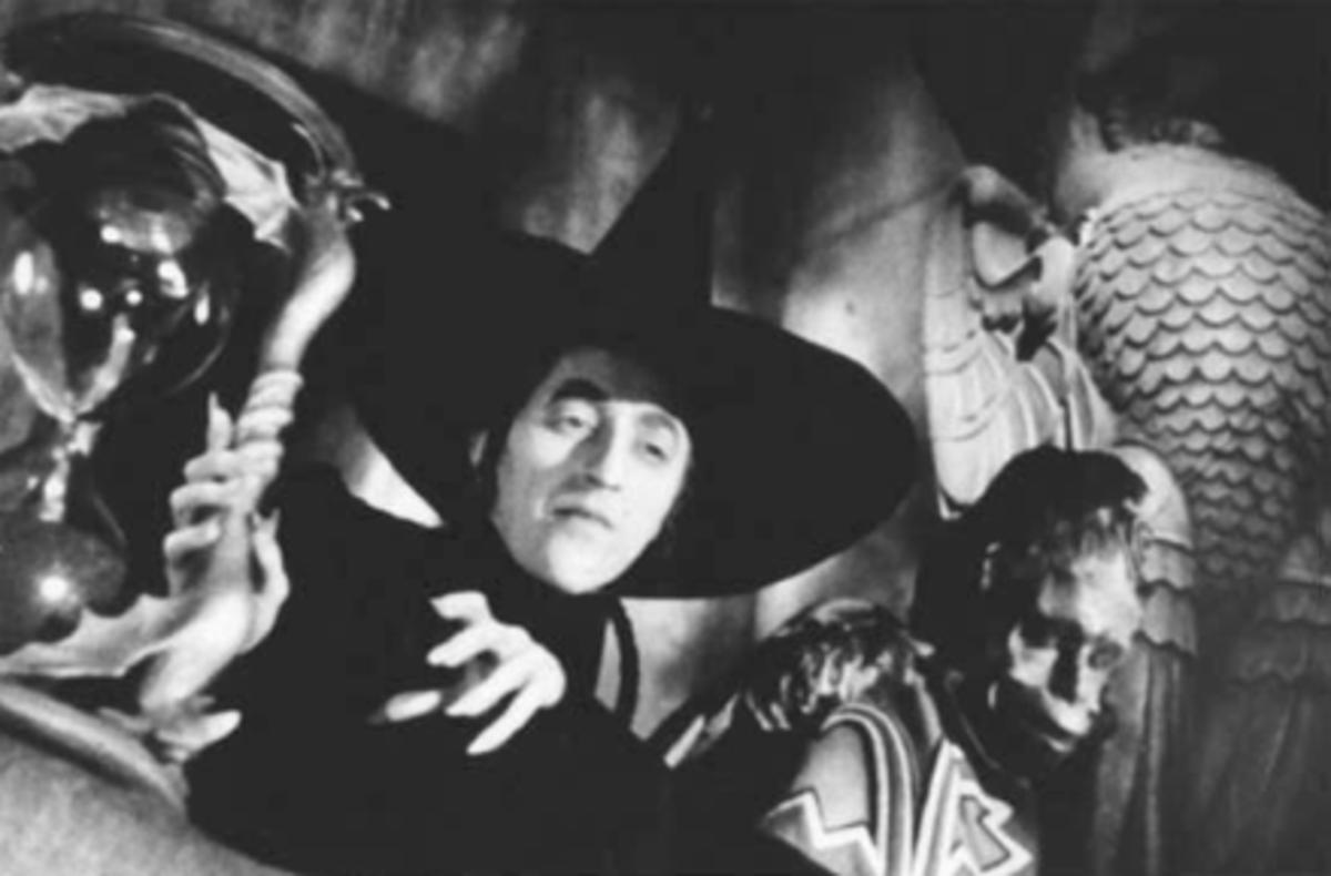 """The Wicked Witch of the West (Margaret Hamilton) with her servant Nikko"""