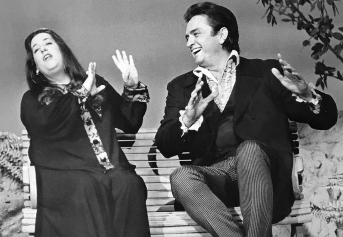 Johnny Cash with guest Cass Elliot who did two guest appearances on the show the first on September 20, 1969 and the second on February 25, 1970
